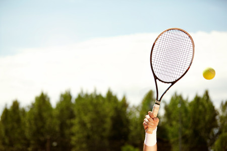 Close up of tennis racket up in air