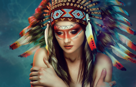 Indian American woman with colorful feather hat feel cold