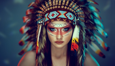 young girl in costume native American Indian background