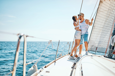 Happy man and woman enjoying on luxury boat Banque d'images - 122814995