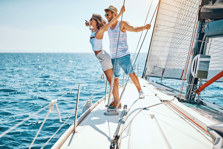 Happy loving man with girl enjoying cruise