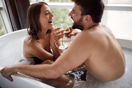 Romantic moments in the bathroom - Happy young couple have fun in bathroom