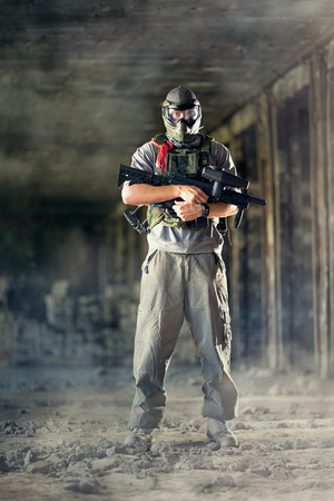 Paintball player posing inside of runs