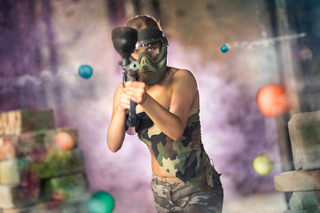 Woman paintball player with marker gun Stock fotó