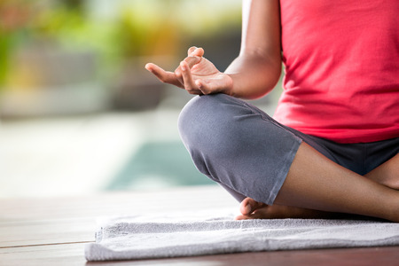 Close-up of woman hands in yoga pose outdoors