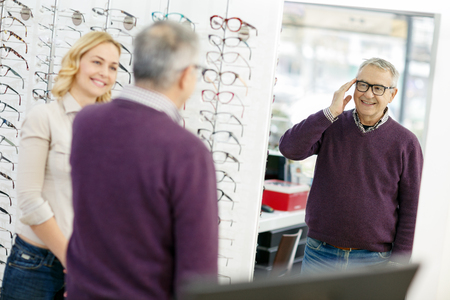 Senior man look in mirror new model of frame glasses