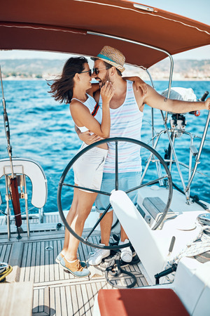 Romantic vacation and luxury travel. Happy couple on a sailboat