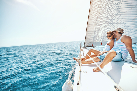 Young Couple Relaxing on a Yacht in the summer.