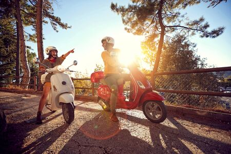 Happy couple traveling on motorcycle and having fun.