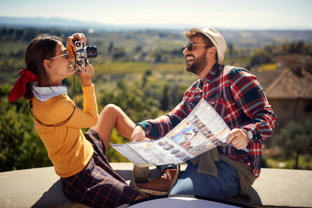 Fun travel – Happy couple enjoying in vacation time and taking picture.