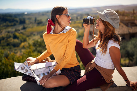 Fun travel – Happy friends enjoying in vacation time and taking picture. Stock Photo