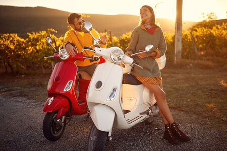 Romantic young couple riding on a scooter in old European. Stock Photo