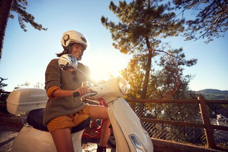 Happy woman traveling on motorcycle and having fun.