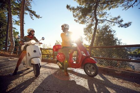 Cheerful young woman and man traveling on motorcycle and looking at Italy on vacation Stock fotó