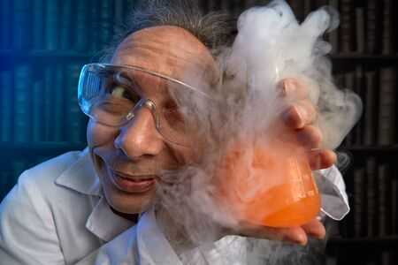 Crazy scientist to worship refers to his experiment, funny chemist Stock fotó
