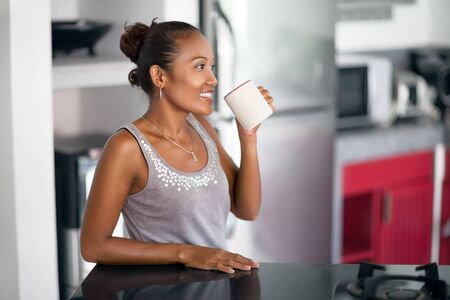 Happy Indonesian woman enjoying in coffee