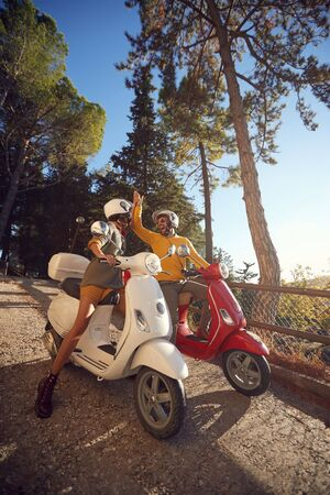 young couple riding a scooter and looking at Italy on vacation Stock fotó
