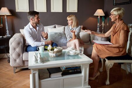Psychologist at workplace working with husband and wife