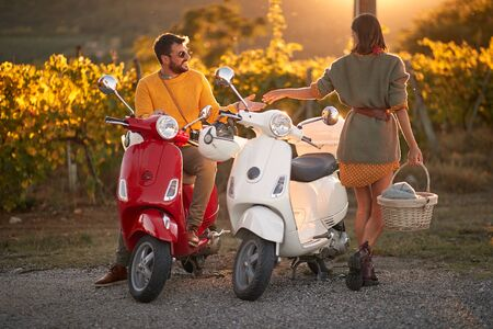 Romantic road trip on scooter at beautiful sunset on vacation. Stock fotó