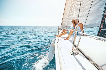 Romance on cruise ship in the summer - young couple hugging on a yacht Stock Photo