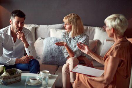 Wife explaining marital problem with husband to psychologist