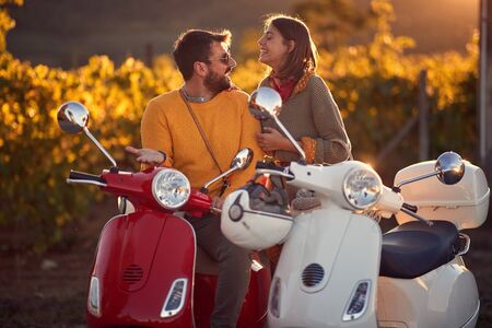young couple on scooter enjoying in romantic road trip. Foto de archivo