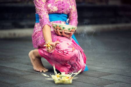 woman in traditional ceremonial clothing with offering for gods Stock Photo