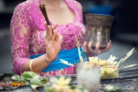 ritual with the offering for God, traditional Balinese praying Stock Photo
