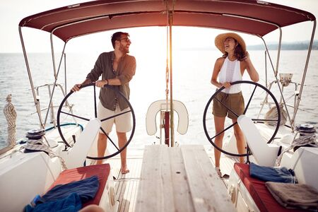 Sexy happy couple on the luxury boat enjoy on vacation Banque d'images - 126342368