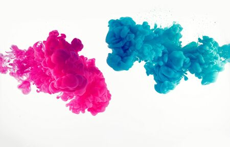 Explosion of blue and mangenta color in water
