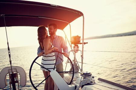 Happy couple enjoying on luxury boat at sunset Banque d'images - 126342380