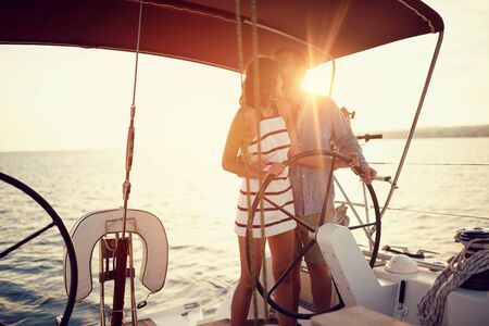 Romantic young couple on the luxury boat together enjoy at sunset Banque d'images - 126342252