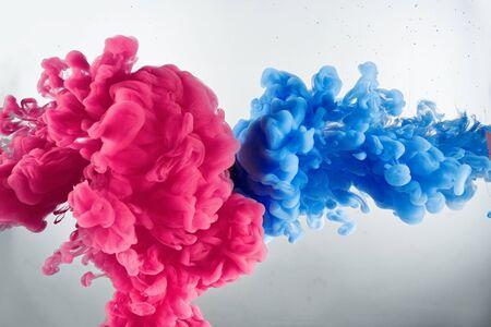 Wolk van kleuren van inktspatten in water Stockfoto