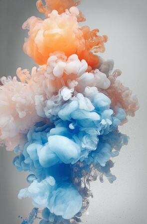 Beautiful color mix in water , orange and blue ink Stock Photo