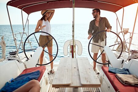 happy couple on the luxury boat enjoy on vacation together Banque d'images - 127238021