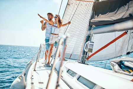 Romantic vacation and luxury travel. Happy man and woman on yacht Banque d'images - 127661986