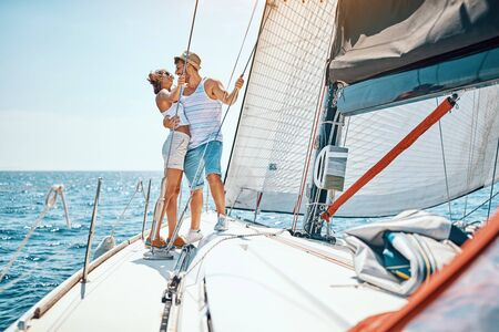 Romantic vacation and luxury travel. Happy young man and woman enjoying on luxury boat Banque d'images - 127662014
