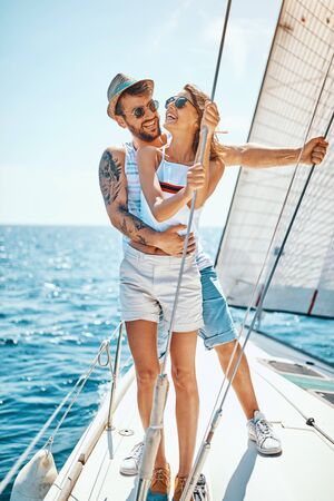 Romantic young man man with girl on a yacht enjoy bright sunny day on vacation
