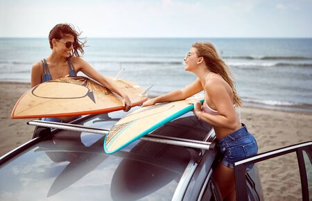 Young girls ready to surf at the beach