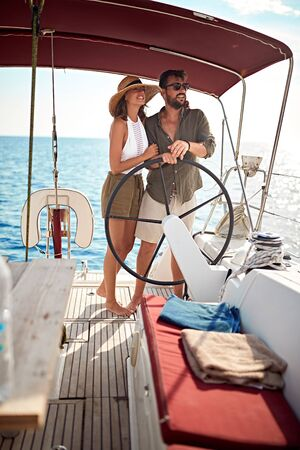Smiling couple on the boat enjoy on summer day and traveling Banque d'images - 127833942