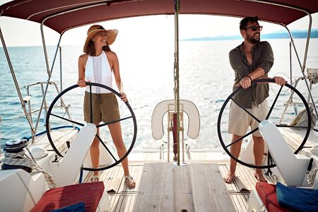 Smiling man and woman on the boat enjoy on summer day and traveling Banque d'images - 127834273