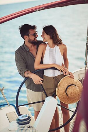 smiling man and woman on the boat enjoy at summer day Banque d'images - 127834274