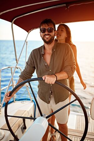Romantic couple on the luxury boat together enjoy at summer day Banque d'images - 127834303