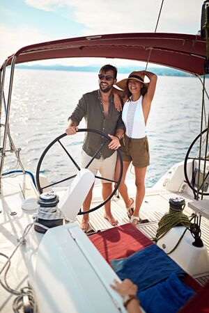 Romantic couple on boat together enjoy at summer day Banque d'images - 127834310