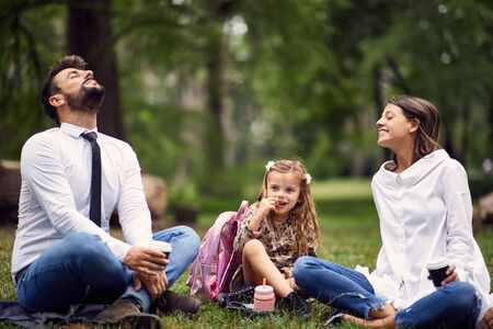 happy family resting in park after school and work Imagens