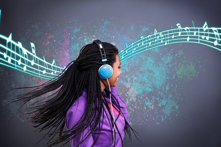 Happy girl listen music on headphones and dancing Stock Photo