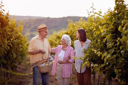 Wine and grapes. Family tradition. Harvesting grapes. Smiling Winegrower family in vineyard