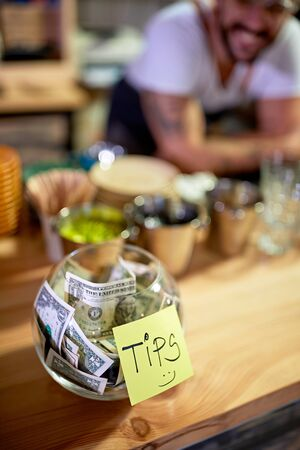 Tips - Money left for a happy employee concept.