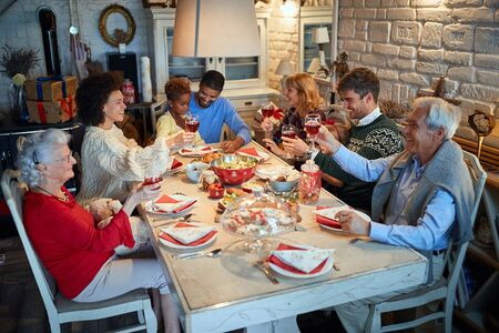 People having Christmas dinner at home with friends