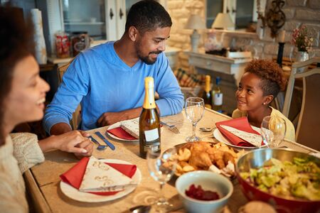 Happy American Family Family dining christmas traditional food at home celebrating christmas eve Banque d'images